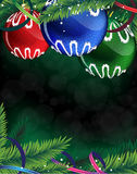 Colorful Christmas balls on a green background Royalty Free Stock Image
