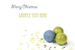 Colorful christmas balls with green stars. Isolated on white royalty free stock image