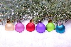 Colorful christmas balls lying on snow Royalty Free Stock Image