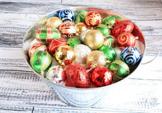 Colorful Christmas balls in metal bucket Royalty Free Stock Image