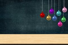 Colorful christmas balls ornaments hanging in the class of school with desk on blackboard background. Picture copy space for art w. Ork design ad or add text Stock Photography