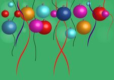 Colorful Christmas balls and ribbons on a green background Royalty Free Stock Photos