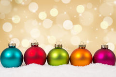 Colorful Christmas balls in a row golden background decoration Royalty Free Stock Photo