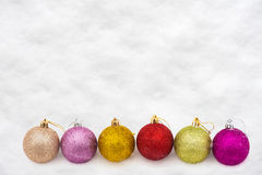 Colorful christmas balls in snow Royalty Free Stock Image