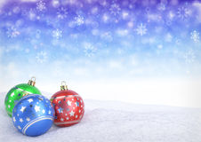 Colorful christmas balls on snow with bokeh background.. Colorful christmas balls on snow with bokeh background - 3D render Royalty Free Stock Images