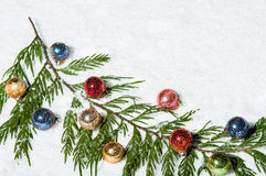 Colorful Christmas balls in the snow Stock Image