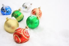 Colorful Christmas balls in snow Royalty Free Stock Photography