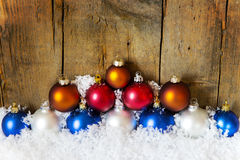 Colorful christmas balls with snow Stock Images