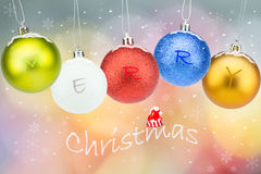 Colorful christmas balls with snowflakes and snow on colorful bokeh background Royalty Free Stock Photography
