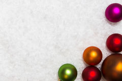 Colorful christmas balls on snowy background Royalty Free Stock Photos