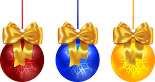 Colorful Christmas balls tied with yellow bow Royalty Free Stock Images