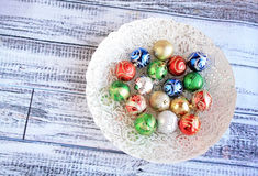 Colorful Christmas balls in white bowl Stock Images