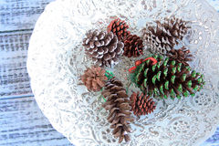 Colorful Christmas balls in white bowl Stock Photo