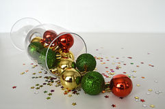 Colorful Christmas balls in wineglass Stock Photos
