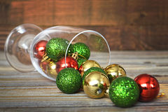 Colorful Christmas balls in wineglass Royalty Free Stock Image