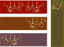 Colorful Christmas Banners. Set of four colorful christmas banners depicting christmas ornaments (baubles) and golden stars; background colors red, brown, green Royalty Free Stock Image