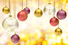 Colorful christmas bauble balls. On a festive background Royalty Free Stock Image