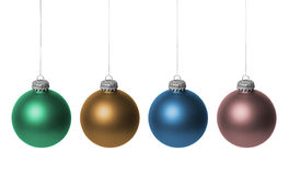 Colorful Christmas baubles. Row of four colorful Christmas bauble decorations hanging down, isolated on white background Royalty Free Stock Photography