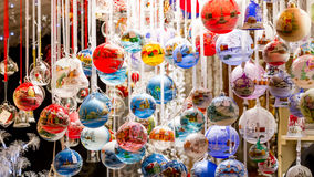 Colorful Christmas Baubles. Colorful Christmas balls hanging from a stall at the Colmar Christmas market Stock Image