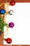 Colorful Christmas baubles and card. Colorful Christmas baubles, star and white card with copy space Royalty Free Stock Photo
