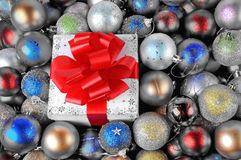 Colorful Christmas baubles with gift box Royalty Free Stock Image