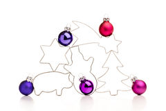 Colorful christmas baubles and gingerbread cookie cutters. Stock Image