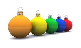 Colorful Christmas baubles. Row of different colored Christmas bauble decorations isolated on white background Royalty Free Stock Images