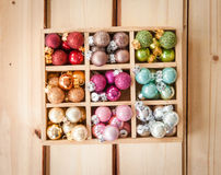 Colorful christmas baubles. On rustic wooden background Royalty Free Stock Photo