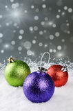Colorful Christmas baubles on silver background Royalty Free Stock Photo