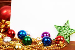 Colorful Christmas baubles and star. Colorful Christmas baubles, star and white card with copy space Stock Images