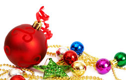 Colorful Christmas baubles and star. On white background with copy space Royalty Free Stock Photo