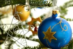 Colorful Christmas baubles and star Royalty Free Stock Photography