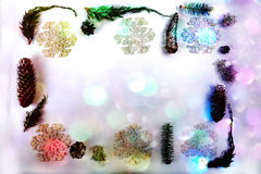 Colorful Christmas Border. Christmas frame from a mix of pine cones, spruce cones, fake, snowflakes, lichen, juniper and spruce twigs. Silver girland of tiny Stock Images