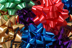 Colorful Christmas bows forming a vivid background. Colorful Christmas bows forming a bright vivid background Royalty Free Stock Photos