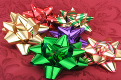 Colorful christmas bows on a red background Royalty Free Stock Image