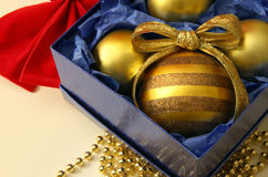 Colorful Christmas bulbs in a box Stock Images