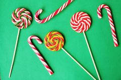 Colorful Christmas candy canes on green background Royalty Free Stock Image