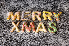 Colorful christmas cookies building the words Merry xmas, icing Royalty Free Stock Photography
