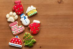 Colorful christmas cookies set lay on wooden table. Holidays food and decoration concept.  royalty free stock photos