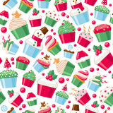 Colorful christmas cupcakes seamless pattern. Sweet holiday bakery. New Year seasonal background. Good for holidays greeting poster banner advertising design Royalty Free Stock Photo
