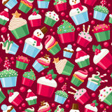 Colorful christmas cupcakes seamless pattern. Sweet holiday bakery. New Year seasonal background. Good for holidays greeting poster banner advertising design Stock Photo