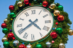 Colorful christmas decoration on vintage clock Stock Images