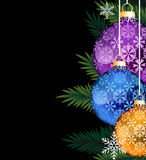 Colorful Christmas decorations. Pine branches with colorful Christmas balls on a black background stock illustration