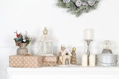 Colorful Christmas decorations on fireplace mantle stock photography