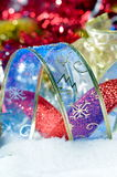 Colorful christmas decorations over snow Royalty Free Stock Images