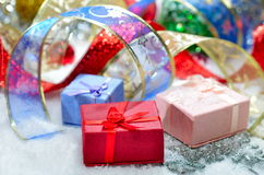 Colorful christmas decorations over snow Stock Photos