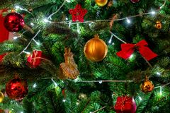 Colorful Christmas decorations on tree for festive background stock photo