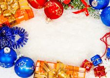 Colorful christmas frame on snow Royalty Free Stock Images