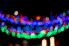 Colorful Christmas garland blurred and defocused with bokeh Stock Photos