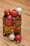 Colorful christmas gift bag filled with christmas baubles Stock Images